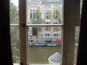 Amsterdam canal through window